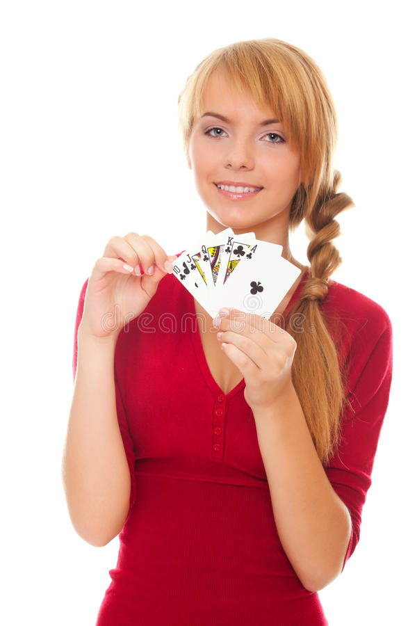 Young woman holding poker card stock images