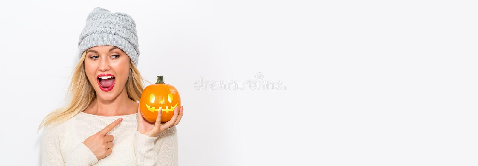 Young woman holding a pumpkin stock images
