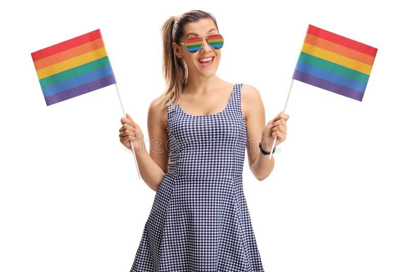 Young woman holding rainbow flags stock photo