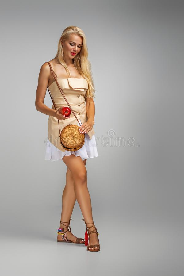 Young woman holding red apple stock photo