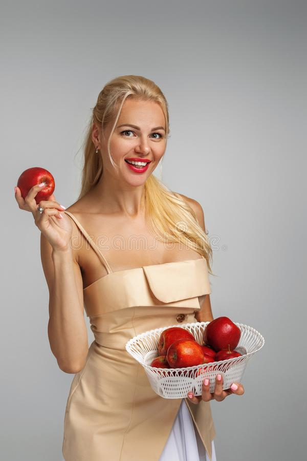 Young woman holding red apple royalty free stock photos