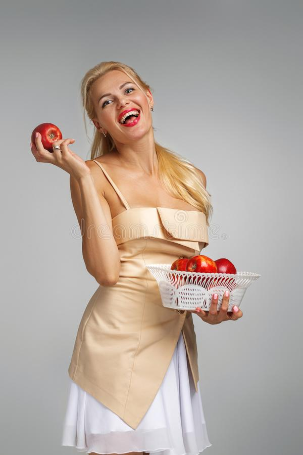 Young woman holding red apple stock photos