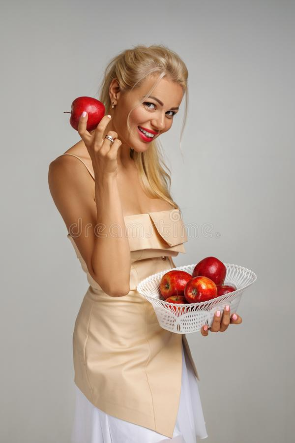 Young woman holding red apple royalty free stock images