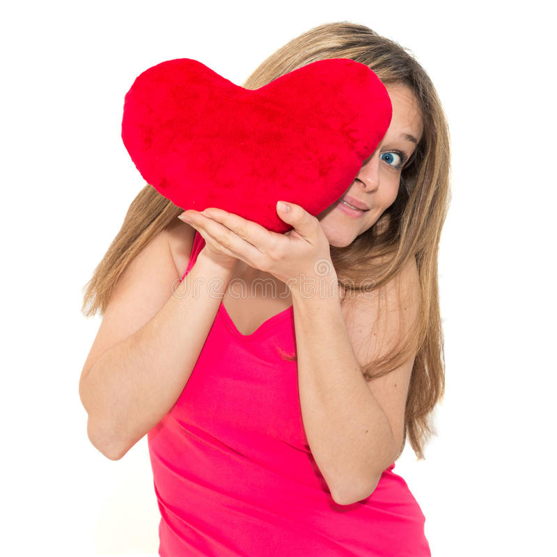 Young woman holding a red heart. Beautiful young woman holding a red heart stock photos