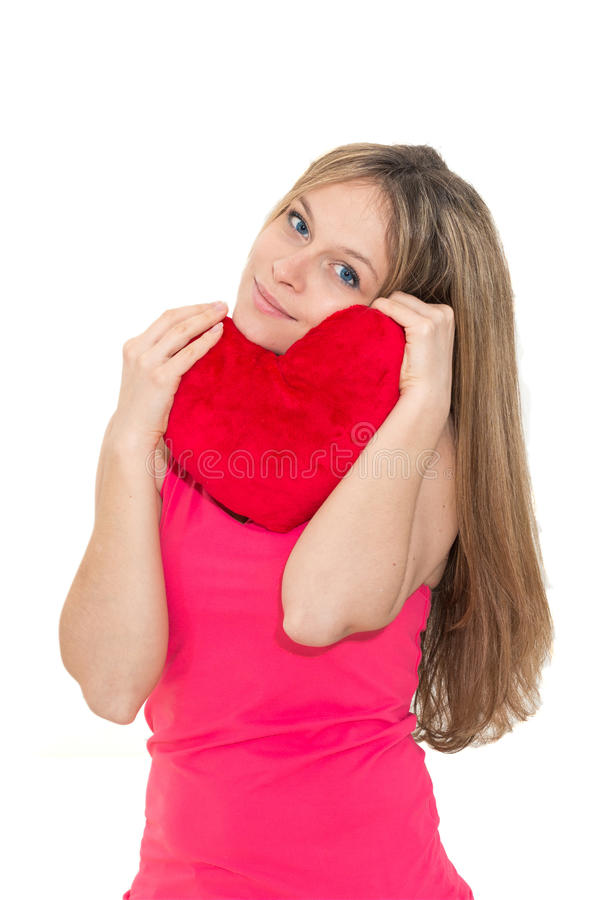 Young woman holding a red heart. Beautiful young woman holding a red heart royalty free stock image