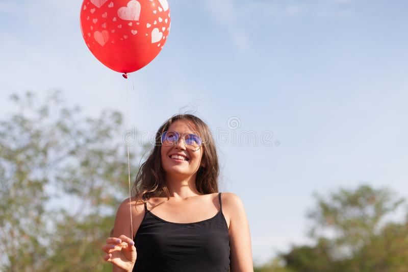 Young woman with balloon stock photos