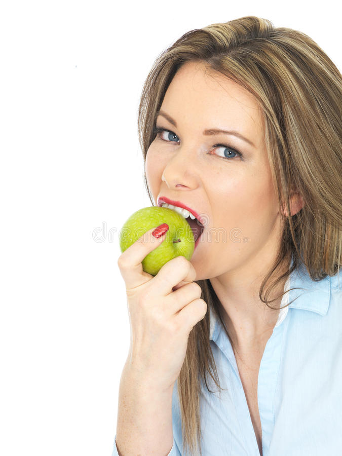 Young Woman Holding a Ripe Juicy Green Apple royalty free stock photography