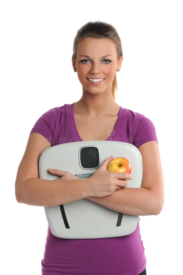 Download Young Woman Holding Scale And Apple Stock Photo - Image: 26177506