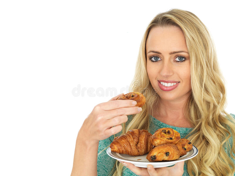 Young Woman Holding a Selection of Danish Pastries. A DSLR royalty free image, of an attractive young woman with blonde hair, eating a pastries from a small royalty free stock photography