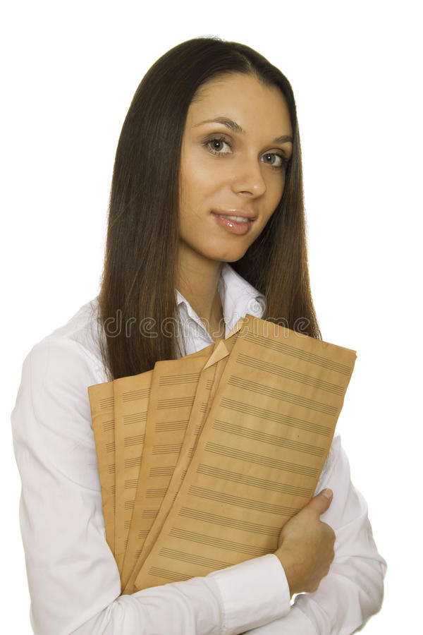 Young woman holding sheet music royalty free stock photography