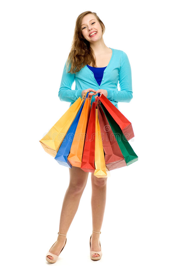 Download Young Woman Holding Shopping Bags Stock Photo - Image of body, sale: 24480712