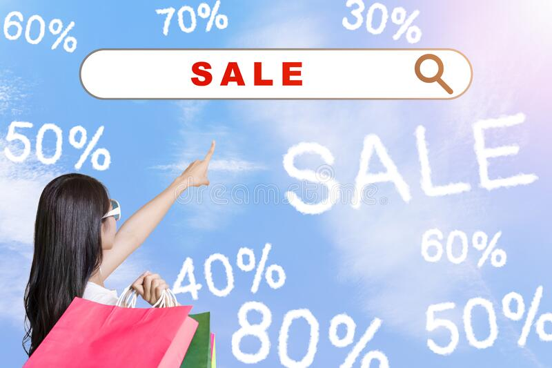 Young woman holding shopping bags and internet shopping  technology concept stock photo