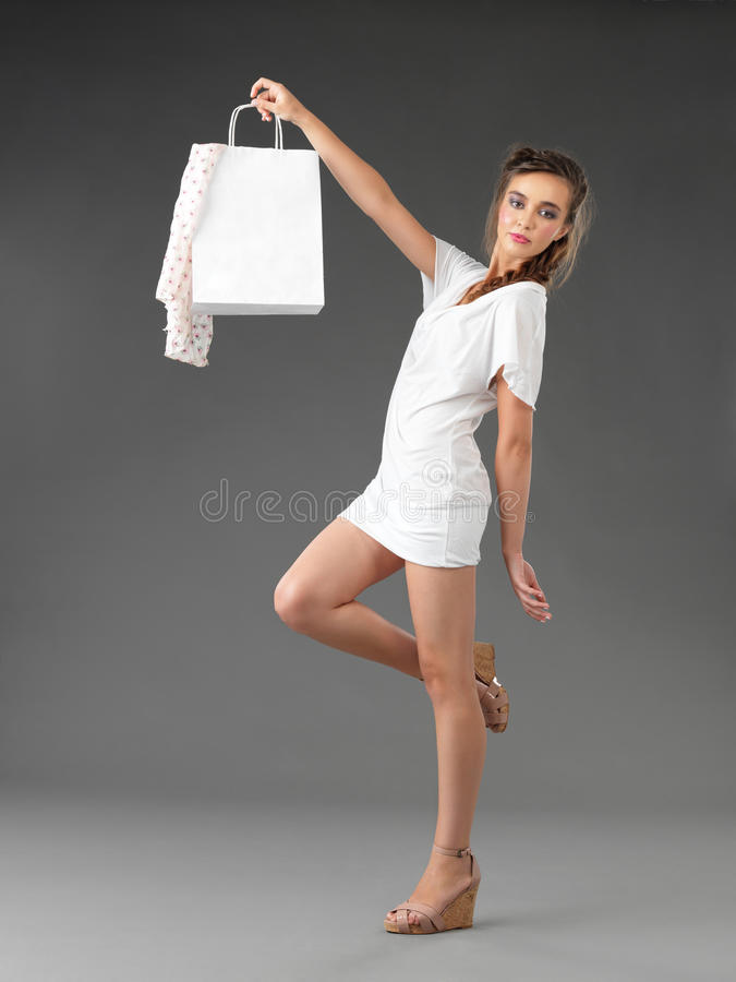 Young woman holding a shoppping bag royalty free stock photos