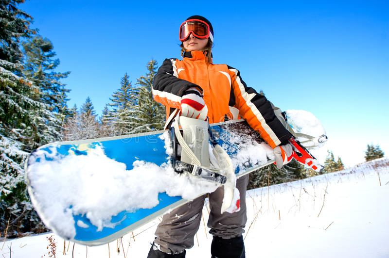 Young woman holding a snowboard. Outdoor image royalty free stock photos
