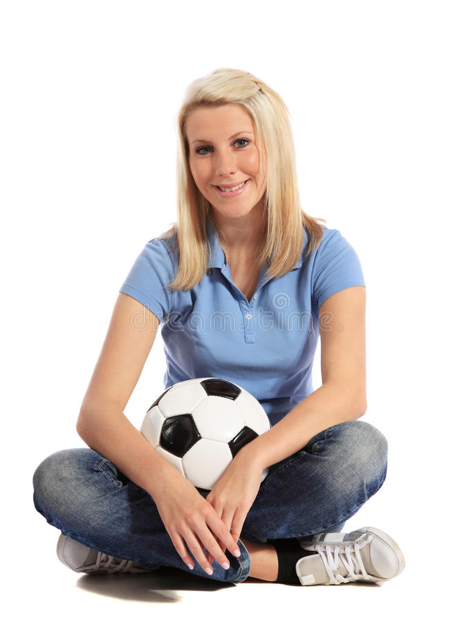 Young woman holding soccer ball stock photo