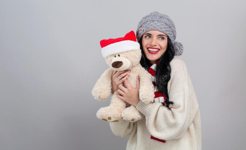 Young woman holding a teddy bear stock photo
