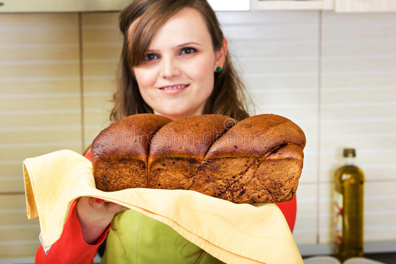 Young woman holding a traditional sponge cake stock images