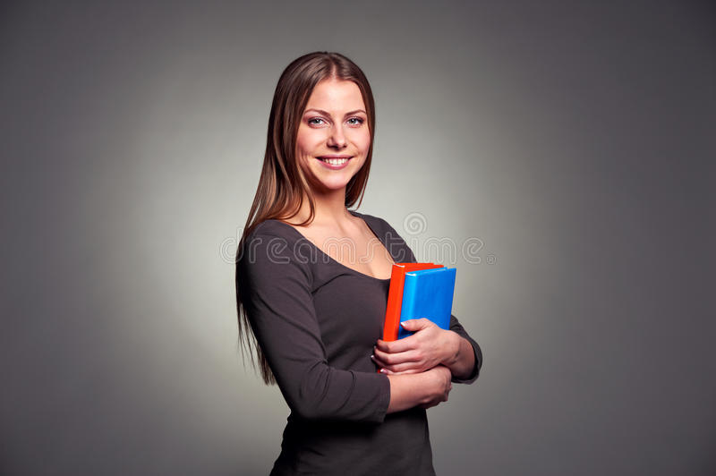 Download Young Woman Holding Two Books Stock Photo - Image of portrait, attractive: 28772062