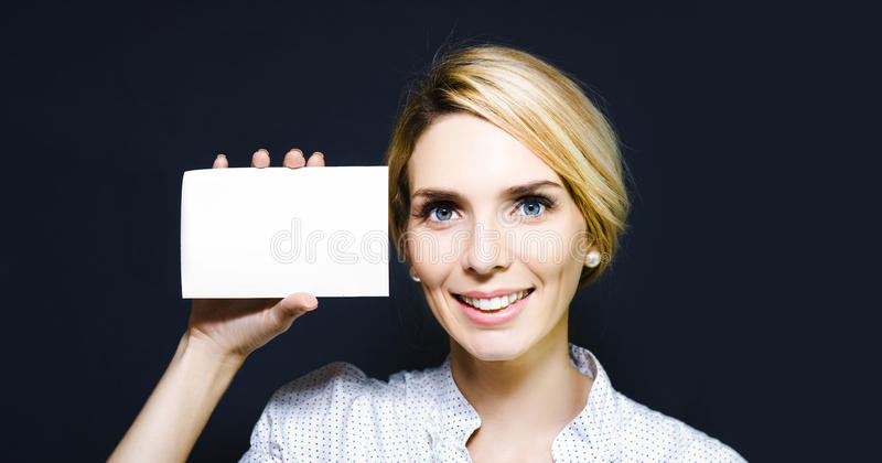 Download Young Woman Holding Up A Blank Card Stock Photo - Image: 24616204