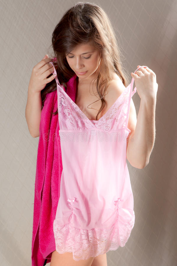 Download Young Woman Holding Up Nightie To Self Stock Photo - Image: 25231674