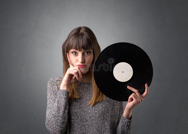 Young woman holding vinyl record stock photo
