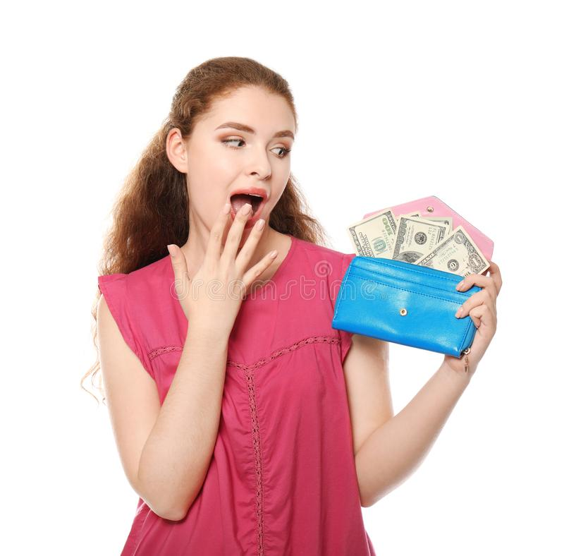 Young woman holding wallet with dollar banknotes on white background. Money savings concept stock photography