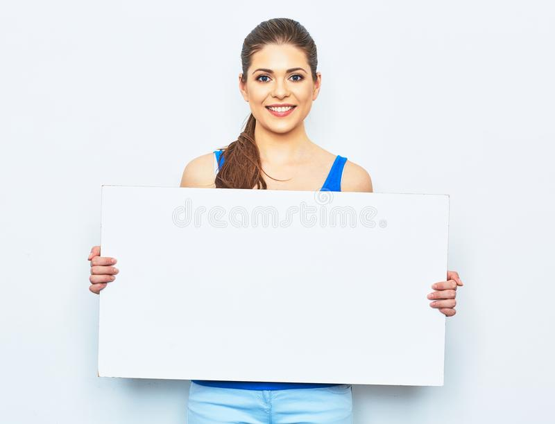 Young woman holding white blank signboard. Studio portrait on white background royalty free stock images