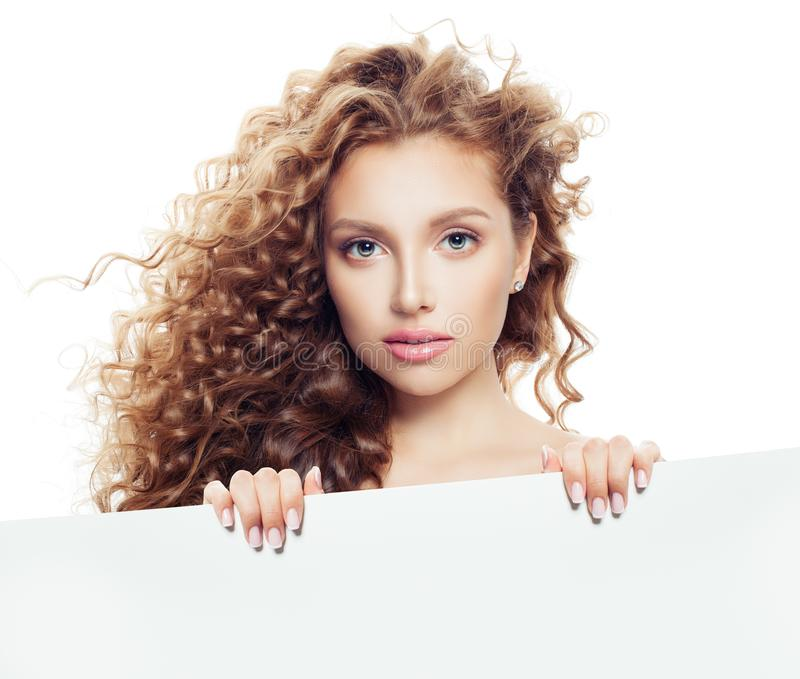 Young woman holding white empty paper board background with copy space for advertising marketing or product placement isolated stock photography