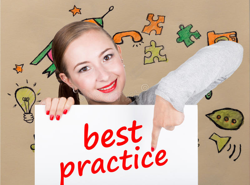 Young woman holding whiteboard with writing word: best practice. Technology, internet, business and marketing. royalty free stock photo