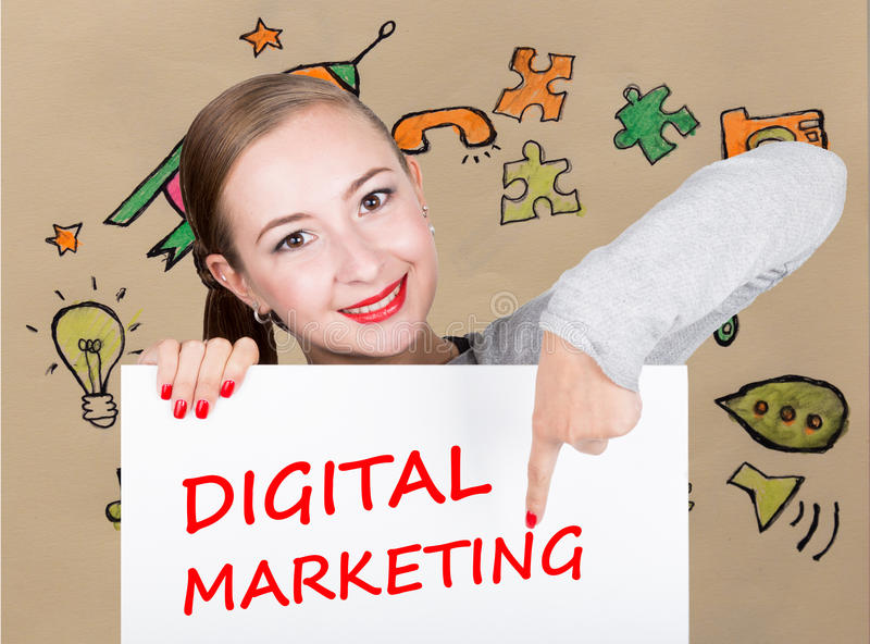 Young woman holding whiteboard with writing word: digital marketing. Technology, internet, business and marketing. stock images