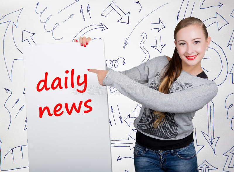 Young woman holding whiteboard with writing word: daily news. Technology, internet, business and marketing. Young woman holding whiteboard with writing word royalty free stock image