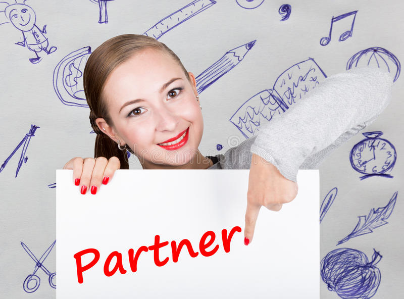Young woman holding whiteboard with writing word: partner. Technology, internet, business and marketing. stock photography