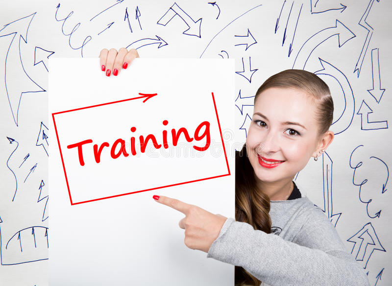 Young woman holding whiteboard with writing word: training. Technology, internet, business and marketing. Young woman holding whiteboard with writing word royalty free stock photos