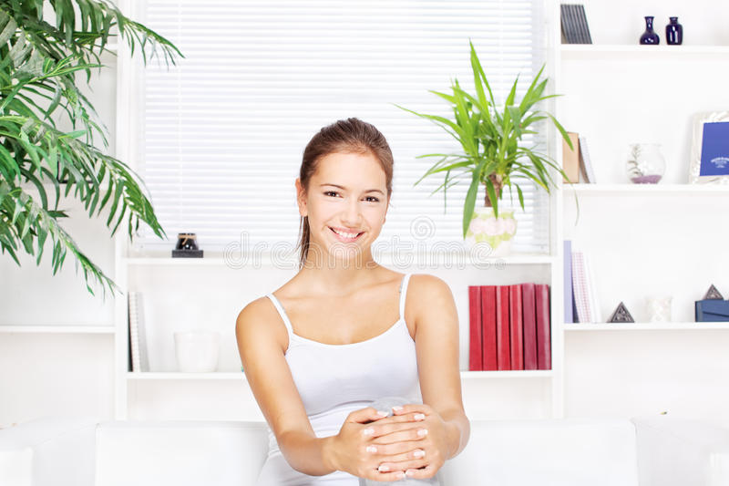 Download Young Woman At Home Sitting On The Sofa Stock Image - Image: 26998009