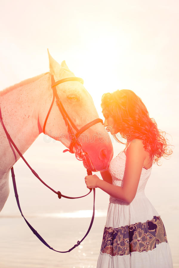 Young woman on a horse. Horseback rider, woman riding horse on b. Beautiful woman on a horse. Horseback rider, woman riding horse on beach royalty free stock photo