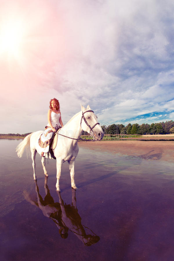 Young woman on a horse. Horseback rider, woman riding horse on b. Beautiful woman on a horse. Horseback rider, woman riding horse on beach royalty free stock photography
