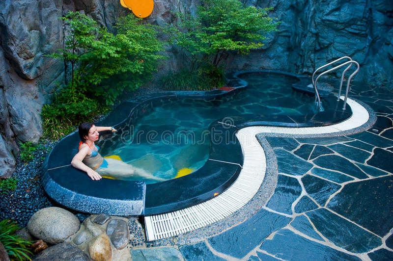 Young woman at the hot thermal spa water pool of the Seorak stock image