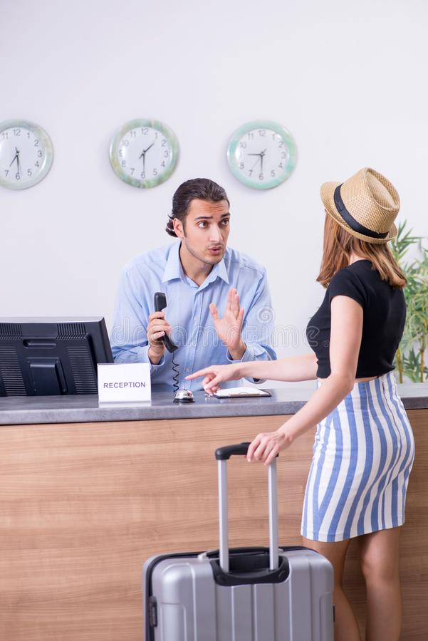 Young woman at hotel reception. The young women at hotel reception royalty free stock photos