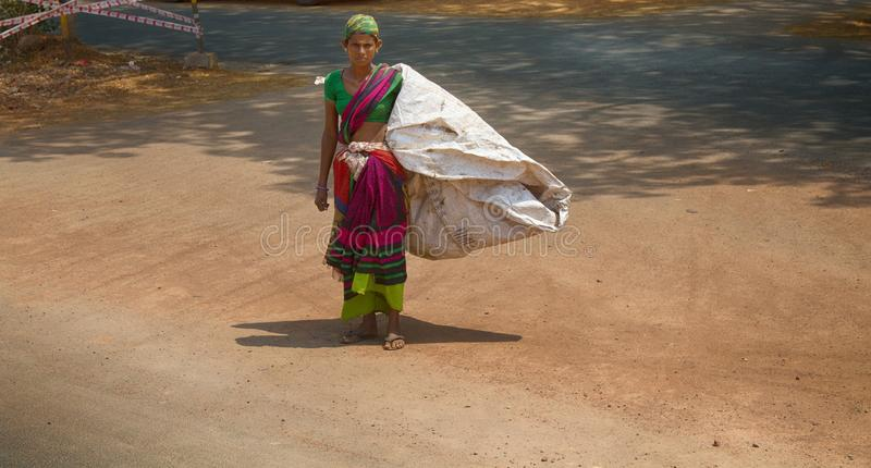 A young woman with a huge bag stock images