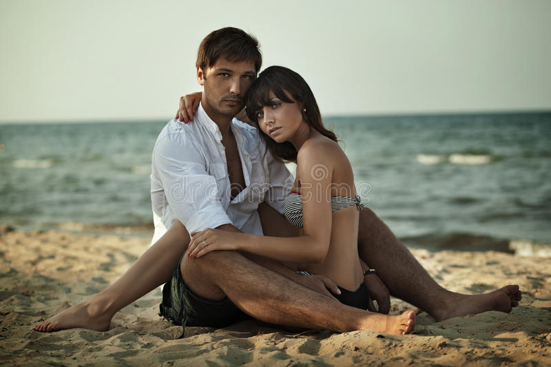 Download Young Woman Hugging On A Beach Stock Photo - Image of full, holding: 27373402