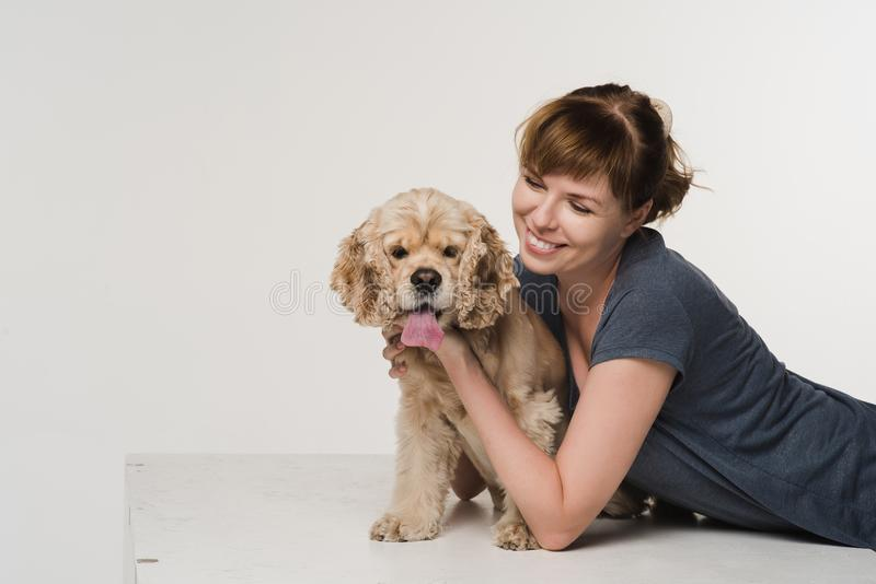 Young woman hugging her spaniel stock images