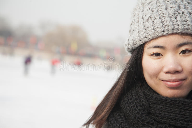 Young woman ice skating portrait, Beijing stock photo