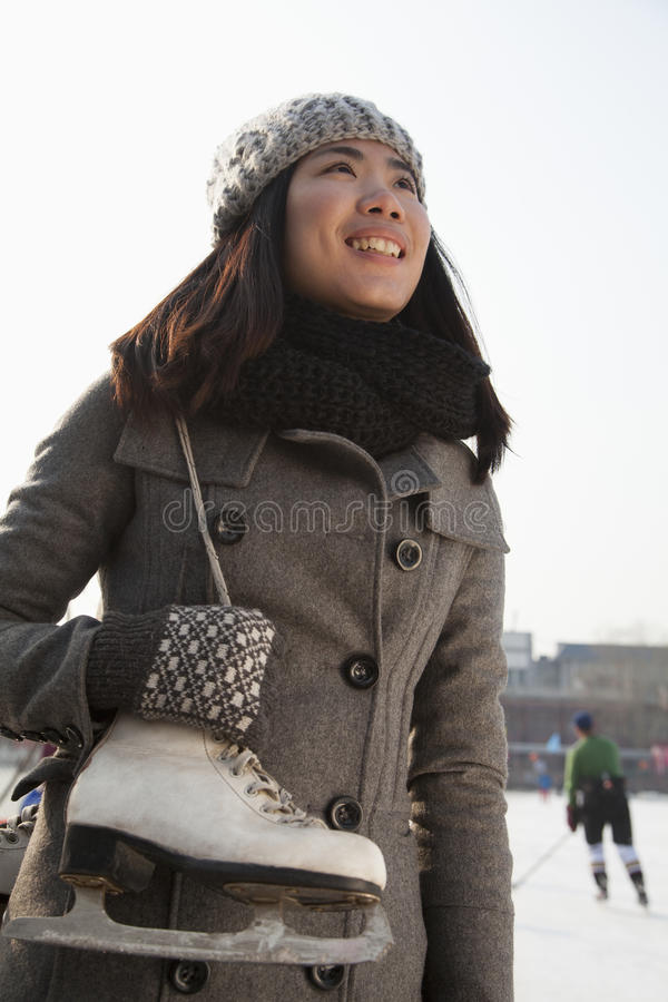 Young woman ice skating portrait, Beijing royalty free stock photography