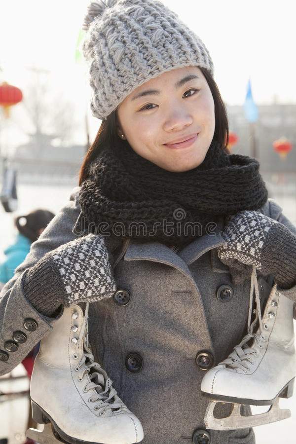 Young woman ice skating portrait, Beijing royalty free stock images