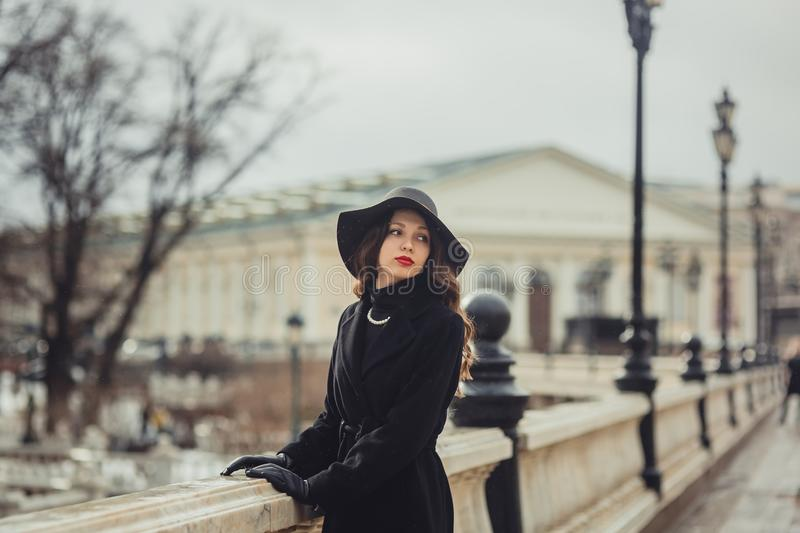 Young woman iin Moscow centre. Young woman in vintage style walking near Moscow Manege at winter day royalty free stock images