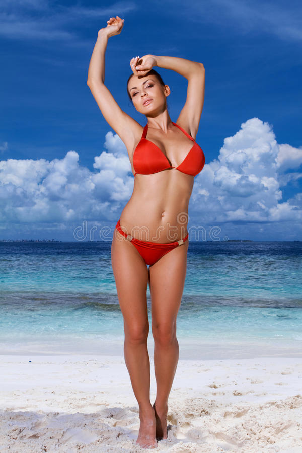Free Young Woman In A Red Bikini At The Beach Royalty Free Stock Photography - 45492597