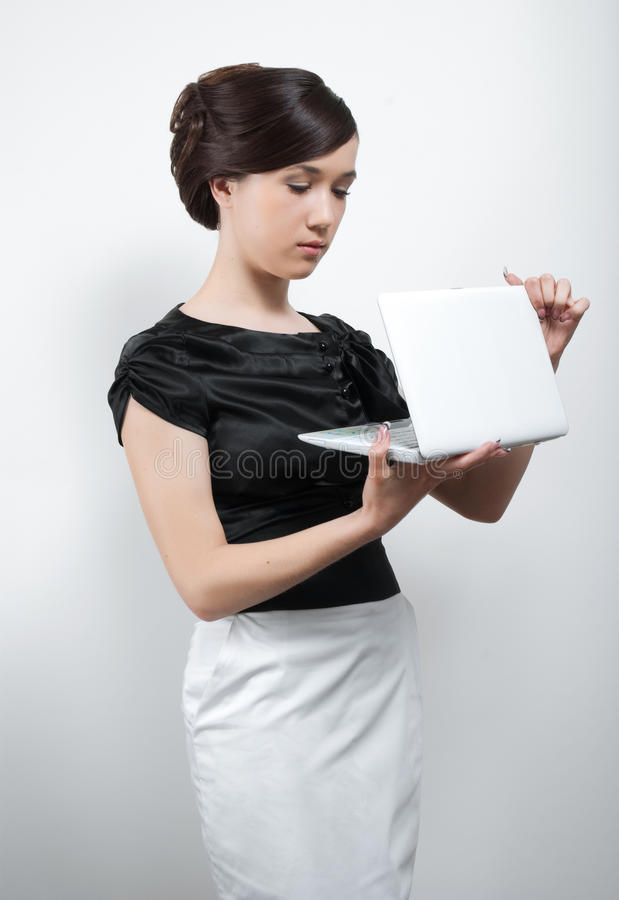 Free Young Woman In Black And White Suit With Laptop Stock Images - 14397584