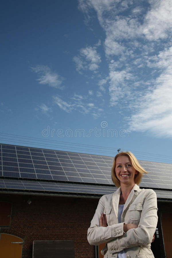 Free Young Woman In Front Of Solar-powered House Stock Photo - 12807770