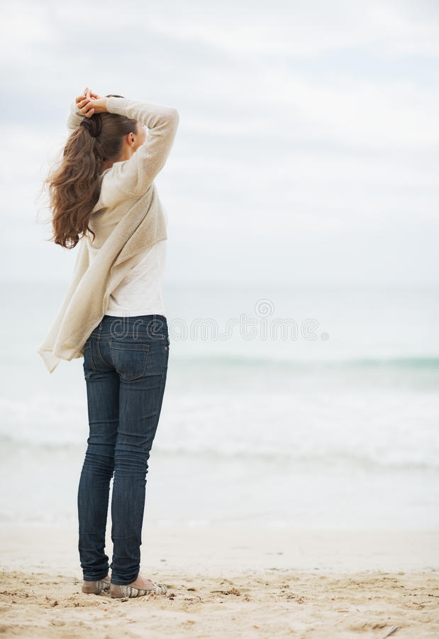 Free Young Woman In Sweater Relaxing On Lonely Beach Royalty Free Stock Photography - 34522047