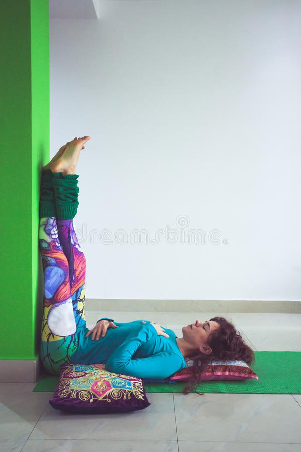 Free Young Woman In Yoga Relaxing Pose With Legs Up The Wall Royalty Free Stock Photography - 109809807